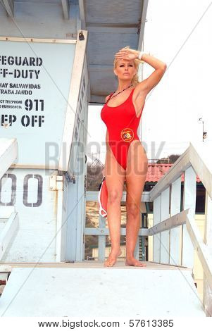 Katie Lohmann on Halloween, wearing an authentic Baywatch swimsuit from the TV series, Zuma Beach, CA. 10-31-09