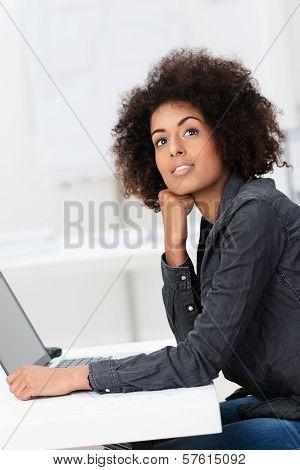 Young Businesswoman Seeking Inspiration