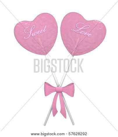 Two pink heart lollipops
