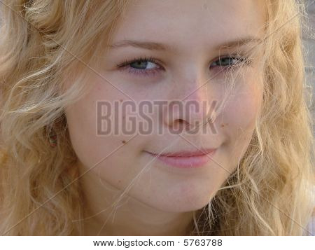 Young Blond Woman With A Curious Expression
