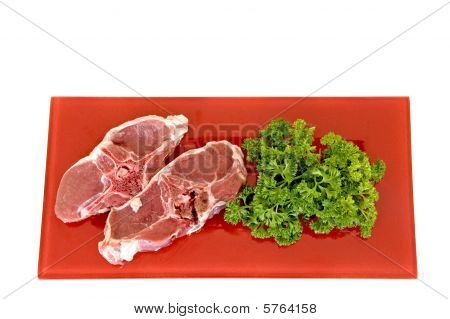 Lamb Chops On Red Plate