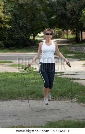 Woman Jump With A Skipping Rope