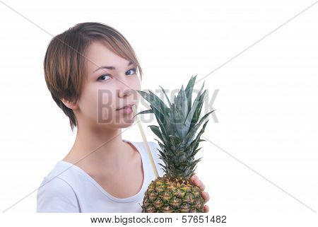 Girl drinks juice from pineapple