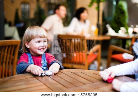 Little Boy  Playing And Smiling