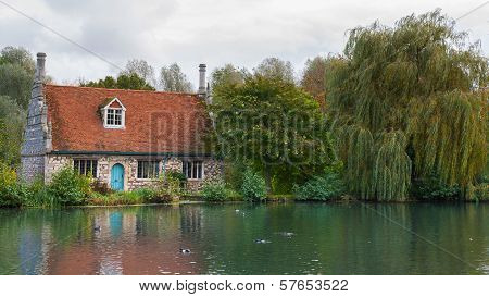 Old cottage by a pond