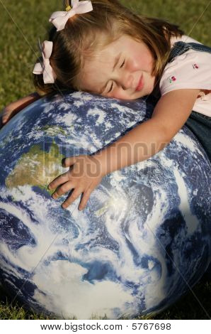Child Crying And Holding The Earth