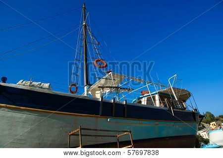 old wooden restored ship in a dry dock