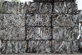 stock photo of bundle  - Piles of scrap metal bundled in cubes for recycling - JPG