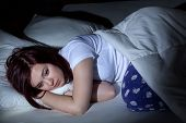 stock photo of sleeping  - Woman cant sleep at the night because of her problems - JPG