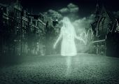 stock photo of evil  - white ghost of a woman walking down the street of the old town