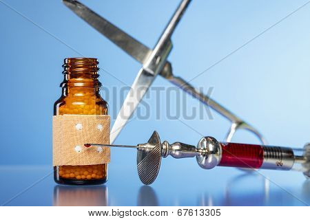 Still Life With Homeopathy Globules. Syringe With Blood,  Plaster And Scissors