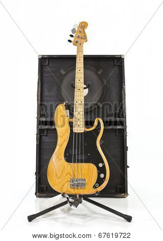 LOS ANGELES, CALIFORNIA - July 27, 2011:  Illustrative editorial photo of a vintage Fender Precision bass guitar with a two 15 inch speaker box.