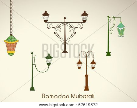 Beautiful floral decorated lamps on shiny beige background for the celebrations of Muslim community holy month Ramadan Mubarak.