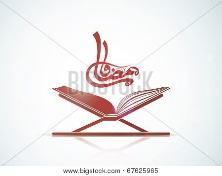 Arabic Islamic calligraphy of text Ramadan Kareem with open religious Islamic book Quran Shareef on grey background.