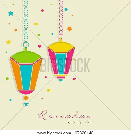 Colorful hanging lanterns on colorful dotted green background for holy month of Muslim community Ramadan Kareem.