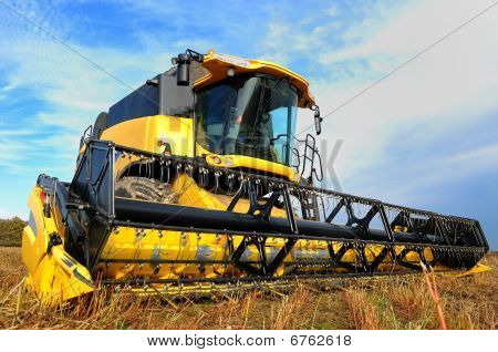 Combine  Harvester In The Field