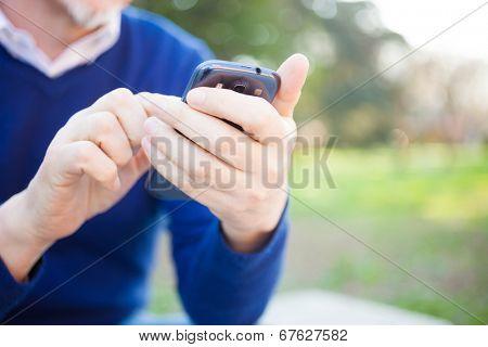 Detail of a man sending a message