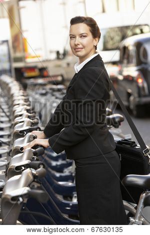 Businesswoman using hire bike