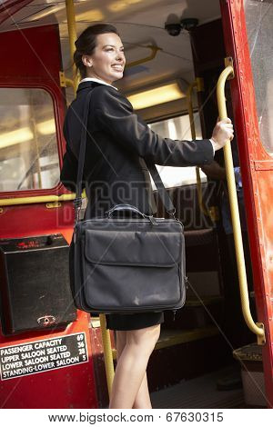 Businesswoman standing on Routemaster bus platform