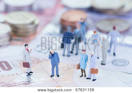 Miniature Business People On Sterling Banknotes