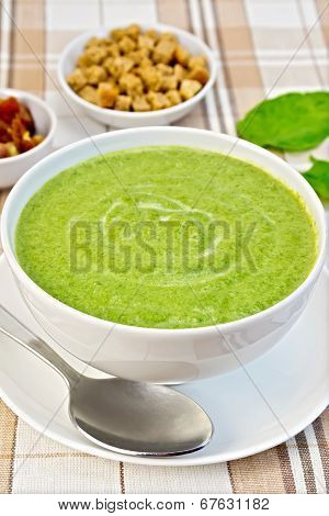 Soup Puree With Spinach And Croutons On Fabric