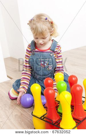 little girl playing with skittles