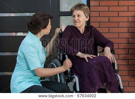Elderly Lady In Front Of House
