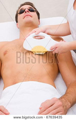 Man Having Pulsed Light Hair Removed