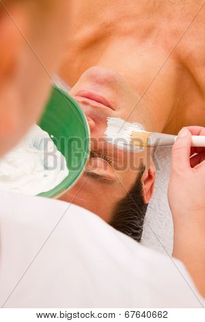 Young Man Getting Facial In A Spa