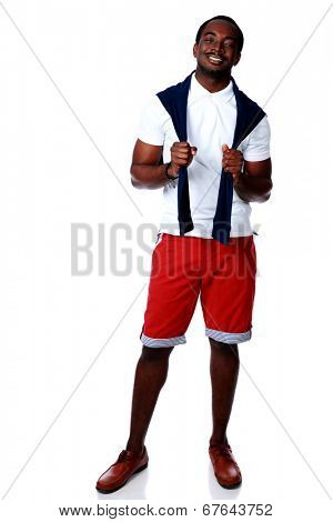 Full length portrait of a happy african man over white background