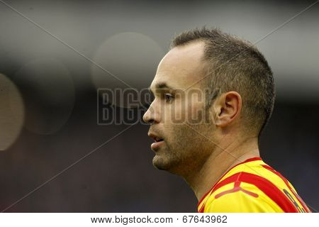 BARCELONA - MARCH, 29: Andres Iniesta of FC Barcelona in action during a Spanish League match against RCD Espanyol at the Estadi Cornella on March 29, 2014 in Barcelona, Spain