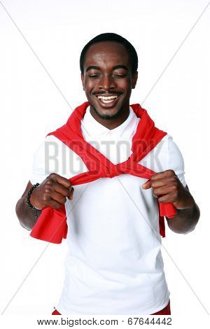 Studio shot of a smiling african man over white background