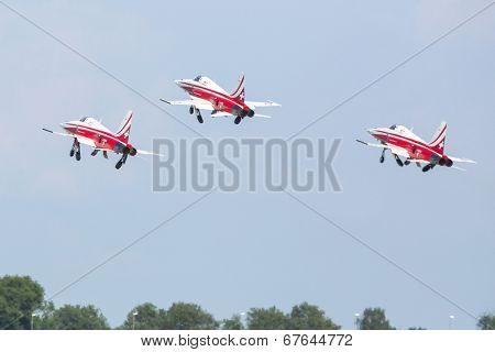 BERLIN, GERMANY - MAY 20, 2014: Aerobatic team Northrop F-5E Tiger II (Patrouille Swiss) demonstration during the International Aerospace Exhibition ILA Berlin Air Show-2014.