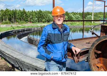 Senior Workman With Orange Hardhat In Sewage Treatment Plant