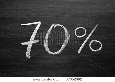 70-percent header written with a chalk on the blackboard