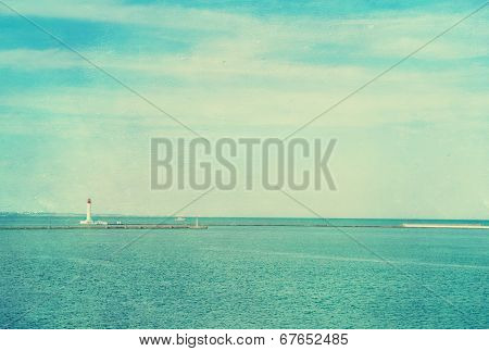 Vintage Photo Of Lighthouse Tower. Nautical Texture Background.