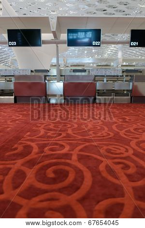 SHENZHEN - APRIL 16: fist class check-in area on April 16, 2014 in Shenzhen, China. Shenzhen Bao'an International Airport is located near Huangtian and Fuyong villages in Bao'an District, ShenZhen
