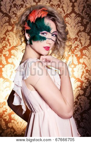 beautiful young woman in a green mysterious venetian mask a new year carnival, Christmas masquerade