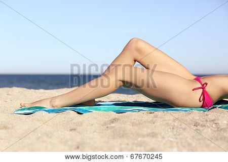 Beauty Perfect Woman Waxing Legs Sunbathing On The Beach