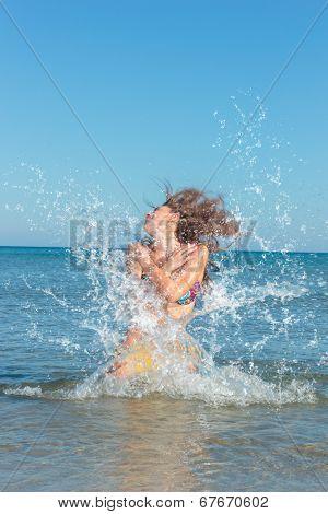 Beauty Model Girl Splashing Water in the ocean. Beautiful Woman in Water