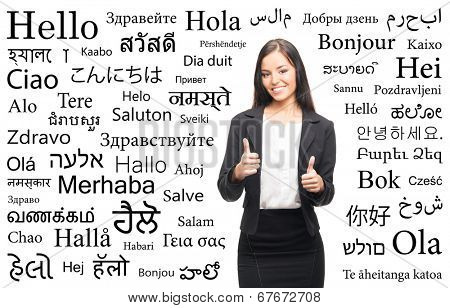 Young attractive woman over the background with a different world languages (language school concept)