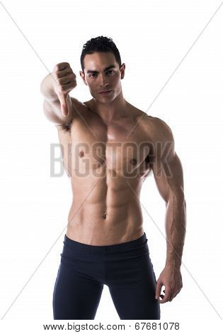 Disappointed Muscular Young Man Doing Thumb Down Sign