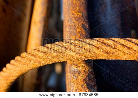 Old Rusty Iron Rope Against Metal Armature