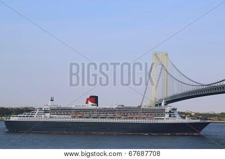 Queen Mary 2 cruise ship in New York Harbor under Verrazano Bridge heading for Canada New England