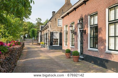 Herengracht  Street With Historic Houses In The Dutch Village Of Drimmelen