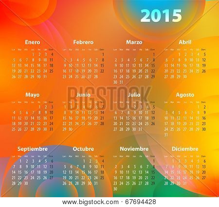 Spanish Calendar For 2015 On Abstract Circles. Mondays First