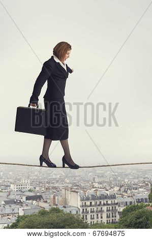 Businesswoman Walking A Tightrope