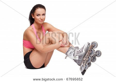 Sexy Sporty Brunette Woman On Roller Blades