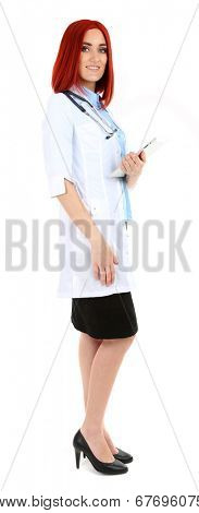 Young beautiful doctor holding tablet isolated on white
