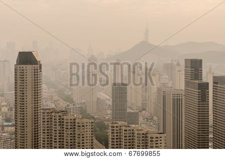 The City's Blocks And Buildings Shrouded In A Pollution Haze.